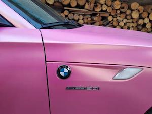 pink BMW car in village