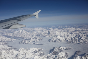 airplane view of Tibet flying through the snowland